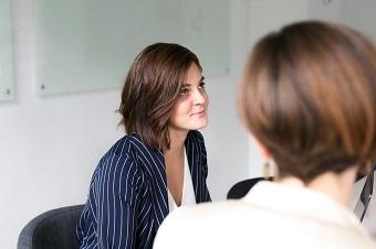1woman-listening-at-team-meeting_925x